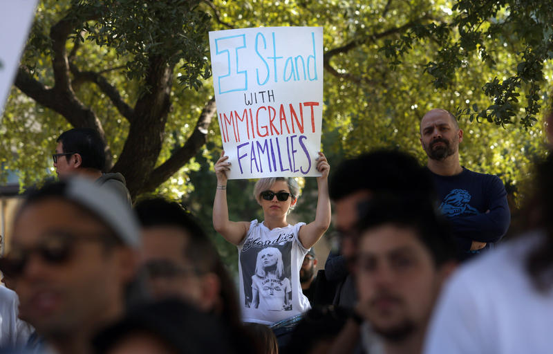 A protester at a City Hall rally in support of Austin's immigrant community on November 13, 2016.