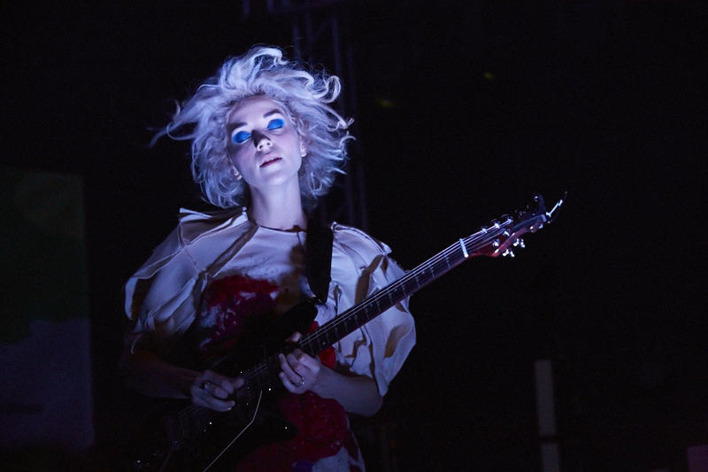 "Annie Clark, a Dallas native, performs as St. Vincent. She's pictured here at South By Southwest in Austin in 2014. She's one of dozens of artists that oppose Texas' ""bathroom bill."""