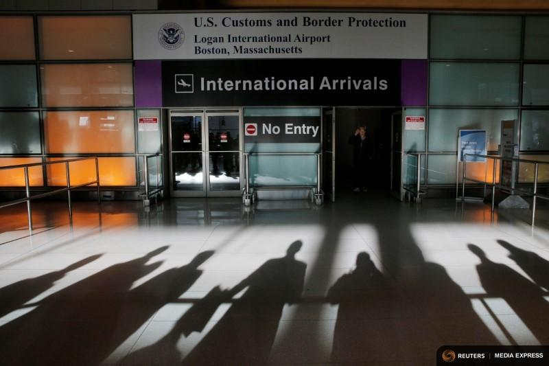 An international traveler arrives on Sunday, Jan. 30 after President Donald Trump's first executive order at Logan Airport in Boston.