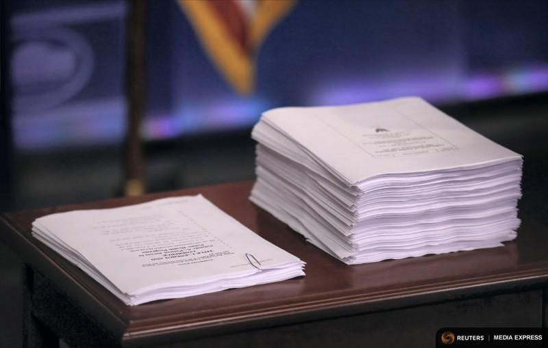 A copy of the repeal and replace recommendations (left) from Republicans in the U.S. House of Representatives next to a copy of the Affordable Care Act at a press briefing at the White House on March 7, 2017.
