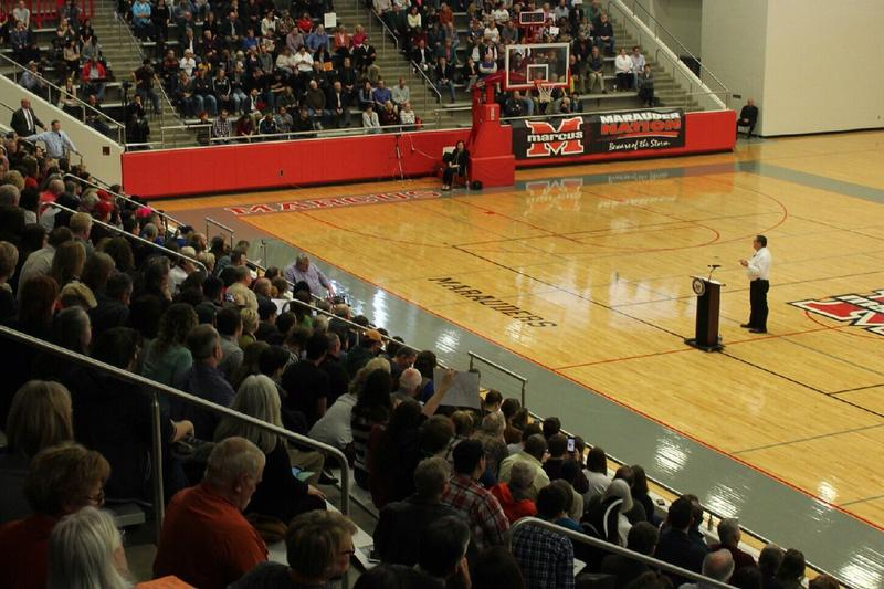 U.S. Rep. Michael Burgess addresses constituents gathered for a town hall at Marcus High School.