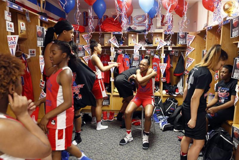 Junior Guard Aniya Thomas (center) and other teammates in the locker room after practice at Duncanville High School. Photographed in Duncanville on Feb. 17, 2017.