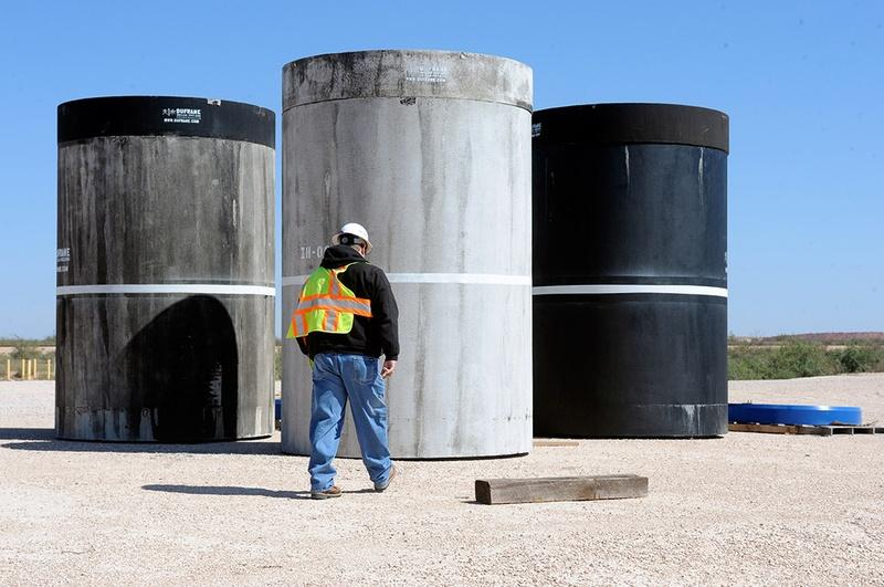 John Ward, operations project task manager at Waste Control Specialists' facility near Andrews, Texas, walks over to inspect concrete canisters that will house drums of nuclear waste