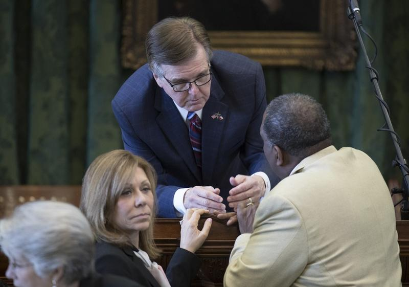 Lt. Gov. Dan Patrick confers with State Sen. Joan Huffman, R-Houston, and Sen. Royce West, D-Dallas, during SB 6 debate on March 14, 2017.