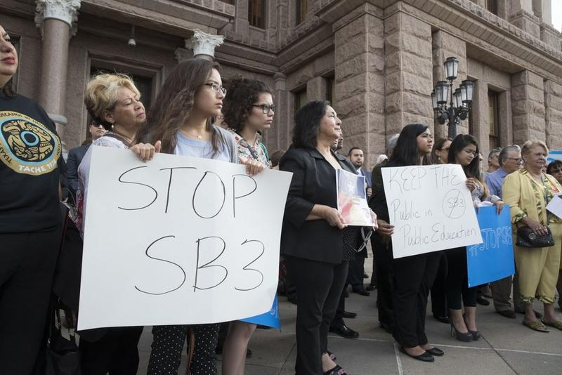 Opponents of SB 3 and school choice legislation making its way through the State Capitol rally on the South Steps March 21, 2017 as bills on Governor Greg Abbott's emergency agenda are considered Tuesday.