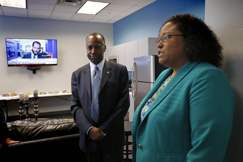 Housing and Urban Development Secretary Ben Carson tours the Hunter Plaza Apartments in Fort Worth with Fort Worth Housing Solutions President Naomi Byrne