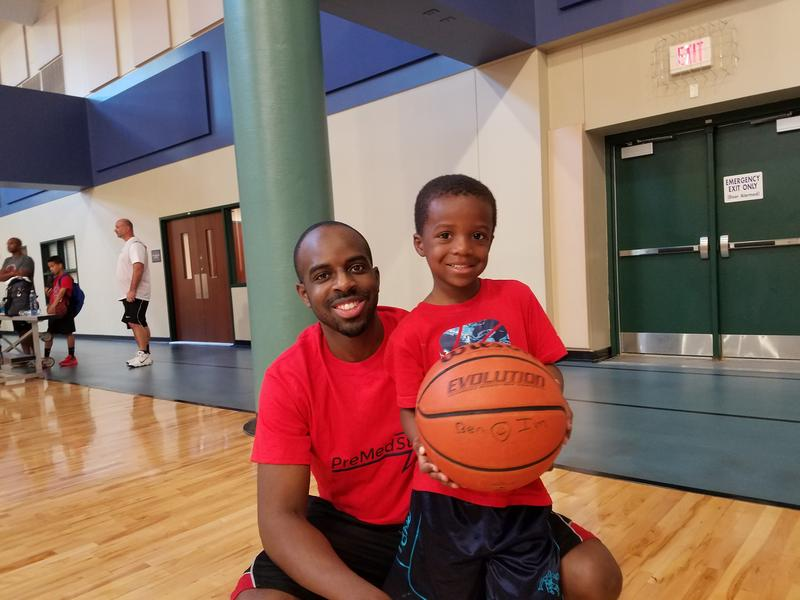 Dr. Dale Okorodudu and his son, Tony, on the basketball court in Plano.
