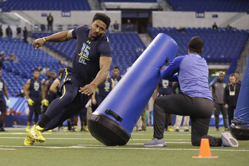 Texas A&M defensive end Myles Garrett runs a drill at the NFL football scouting combine in Indianapolis, Sunday, March 5, 2017.