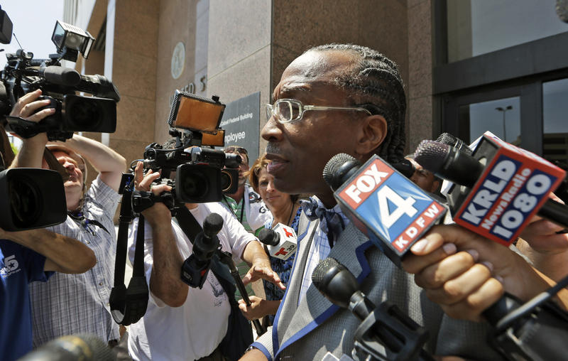 Dallas County Commissioner John Wiley Price is surrounded by media as he leaves the federal courthouse in Dallas on Friday, July 25, 2014.
