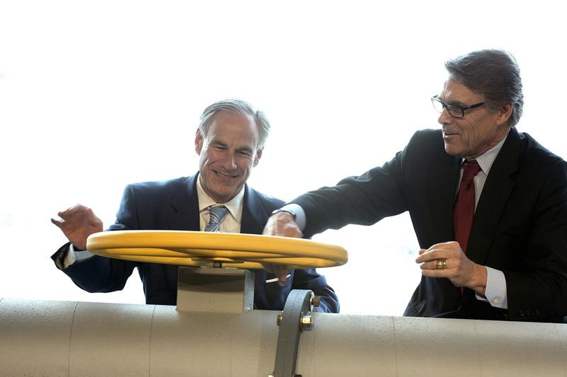 Texas Gov. Greg Abbott, left, and Secretary of Energy Rick Perry join the Petra Nova carbon capture and enhanced oil recovery system partners for a ribbon cutting ceremony at the NRG/ Petra Nova Power Plant in Thompsons on April 13, 2017.