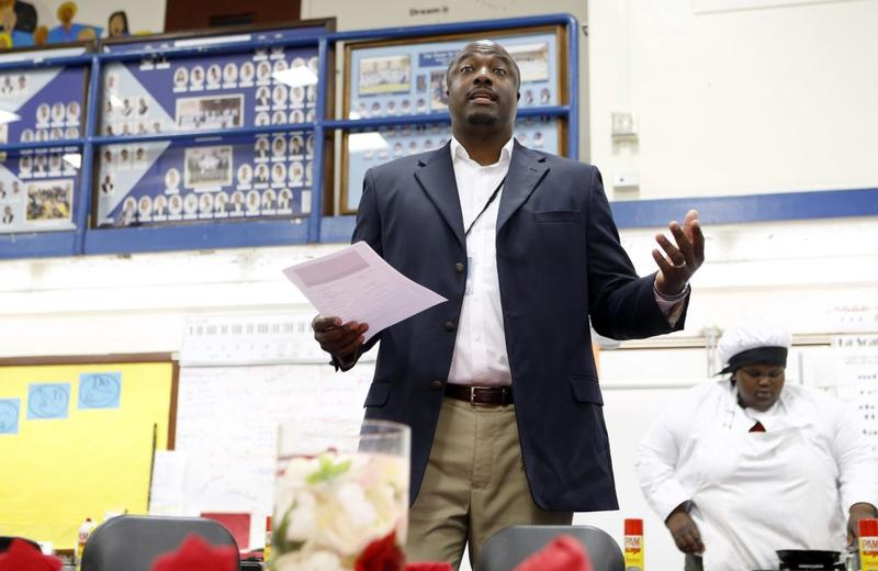 Principal Mario Layne talks to community members during a breakfast at O.D. Wyatt High School in Fort Worth.