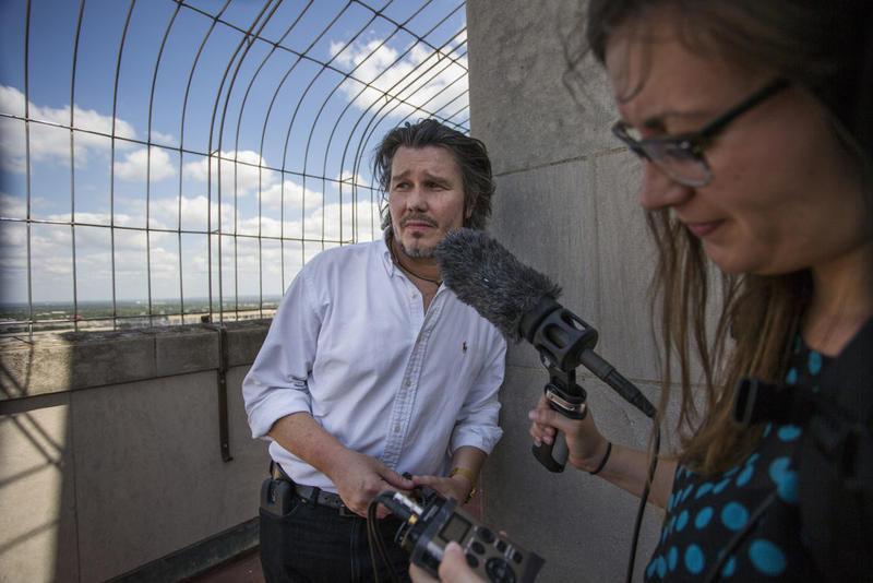 Texas Standard host David Brown and producer Laura Rice record at the spot atop the University of Texas Tower where gunman Charles Whitman carried out his deadly rampage a half-century earlier.