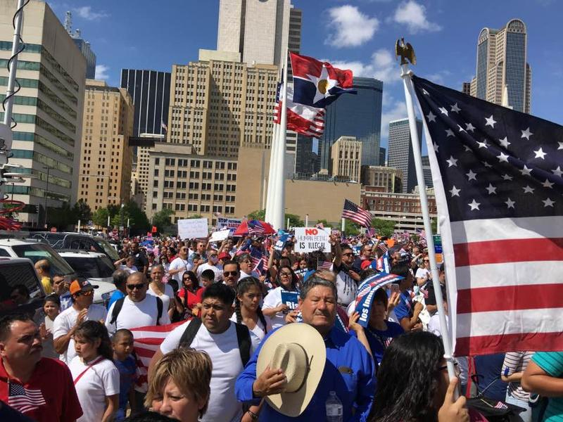 Thousands of mega marchers rally at Dallas City Hall. Speakers demand immigration reform and say education is power.