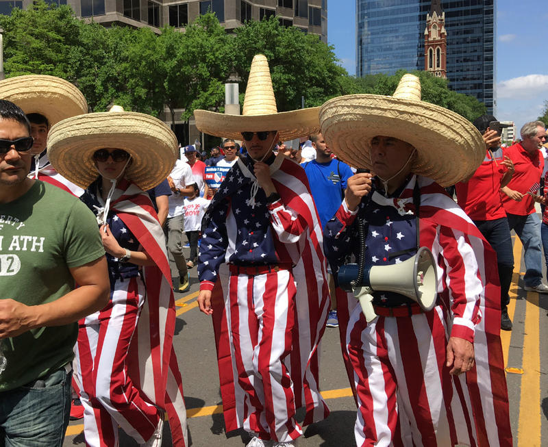 Marchers with sombreros proudly sporting red, white and blue.