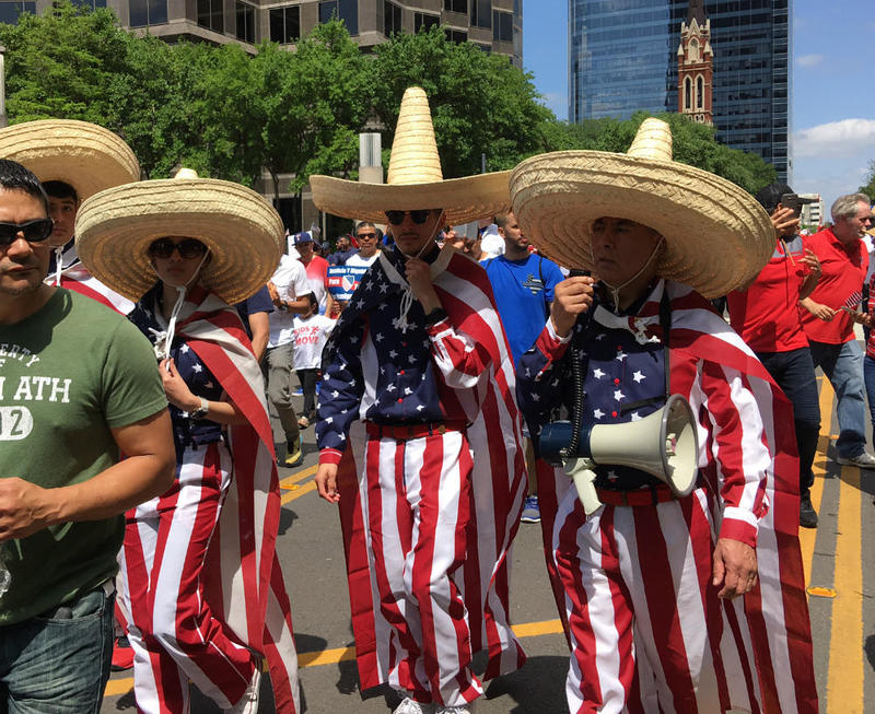 Marchers in sombreros sport red, white and blue.
