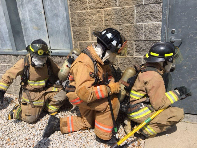 Alexis Dunn and two other Tarrant County College fire academy students prepare for search and rescue.