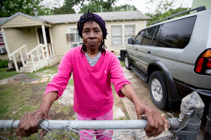 Pearlie Mae Brown, 80, stands outside her home. She has lived her entire life in West Dallas.