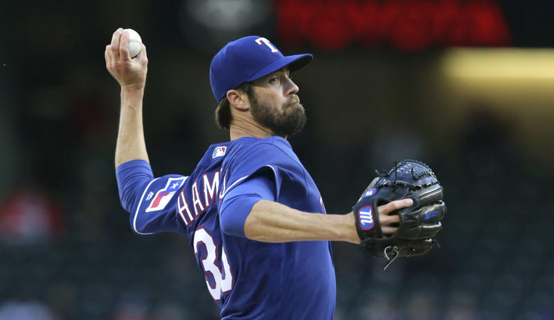 Texas Rangers starting pitcher Cole Hamels throws during the first inning of a baseball game against the Minnesota Twins in Arlington, Texas, Wednesday, April 26, 2017.