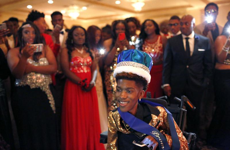 Chance Hawkins is crowned prom king at the Dunbar High School prom in Arlington on May 6.
