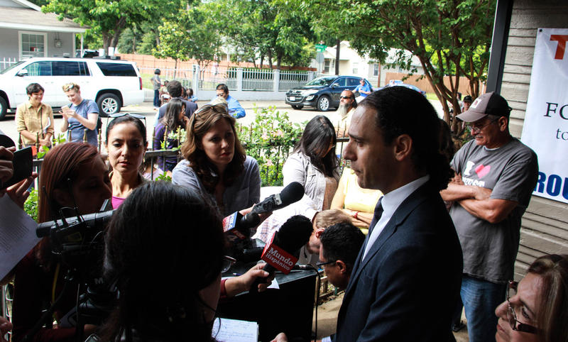 Khraish Khraish, at right, talked with reporters Monday morning in West Dallas.