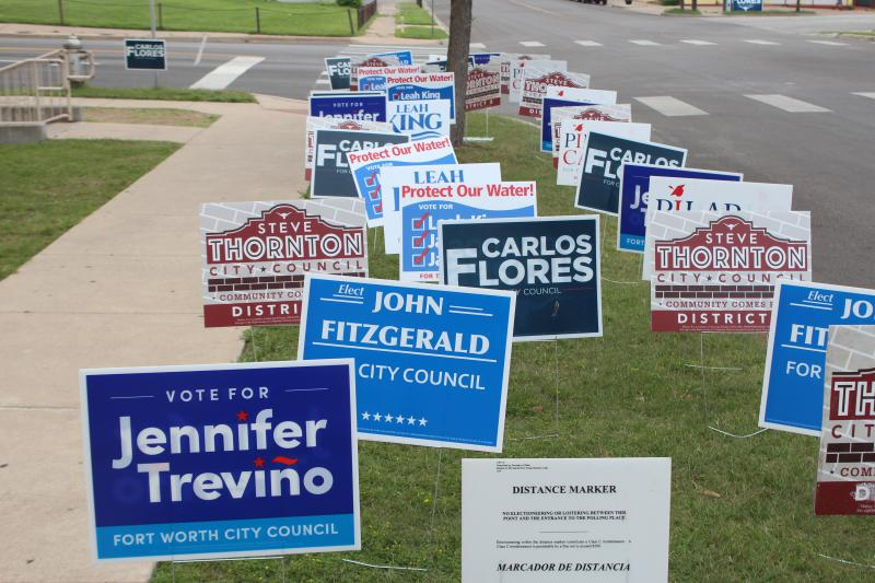 Signs in front of All Saints Catholic Church on Fort Worth's Northside.