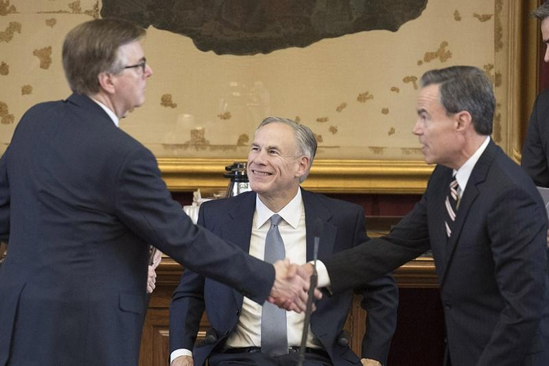Gov. Greg Abbott looks on as Lt. Gov. Dan Patrick (left) and House Speaker Joe Straus shake hands at the Capitol on May 27, 2017.