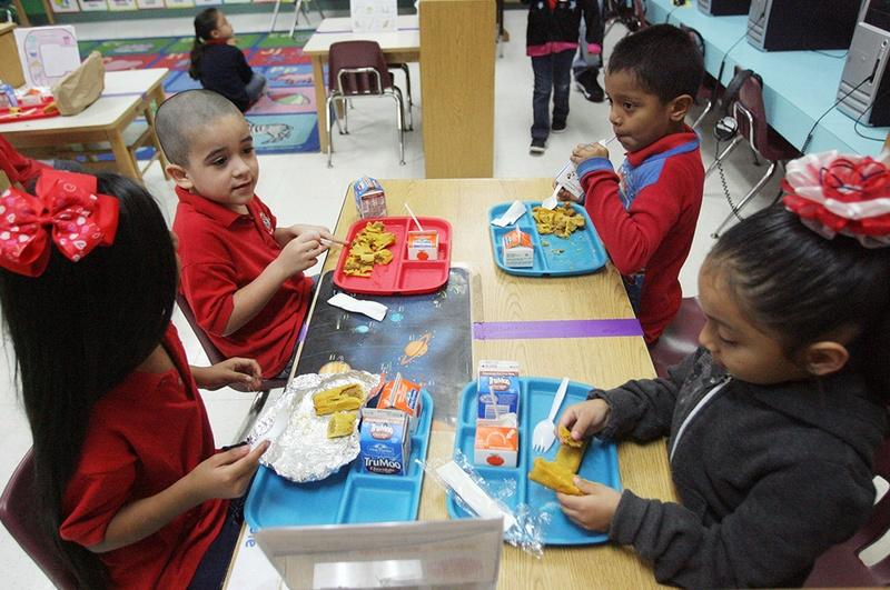 School children at Cantu Elementary in San Juan, Texas, are shown eating breakfast on April 24, 2013.