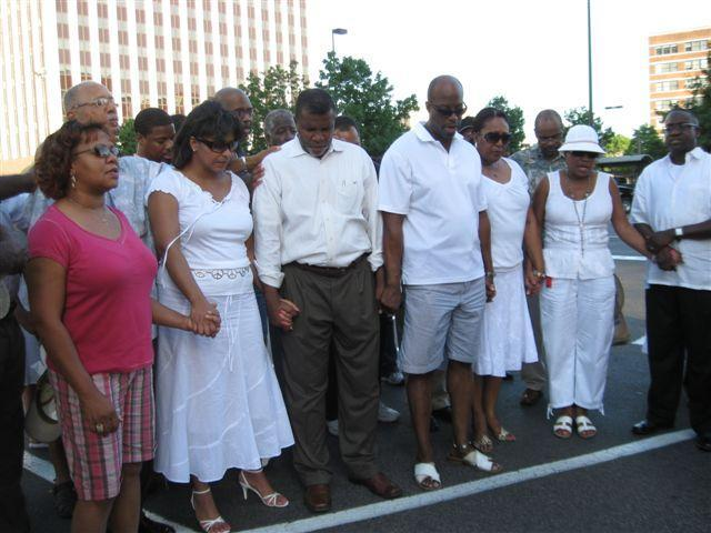 Don Hill, third from left, attended a pre-trial prayer vigil in 2009.