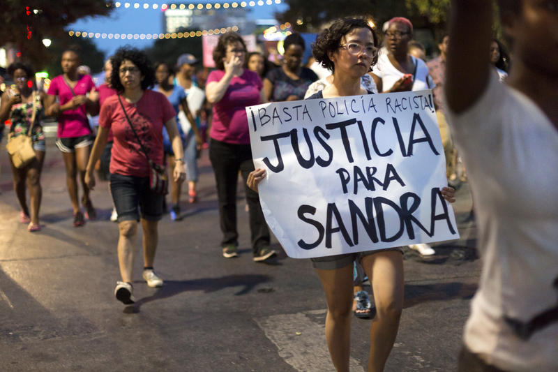 Protesters walk from Victory Grill towards the Texas State Capitol to attend a vigil for Sandra Bland in July 2015.