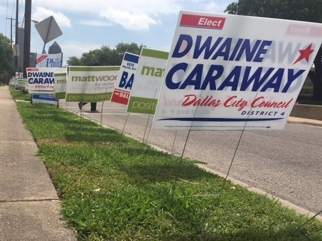 Campaign signs outside an early polling location in East Dallas.
