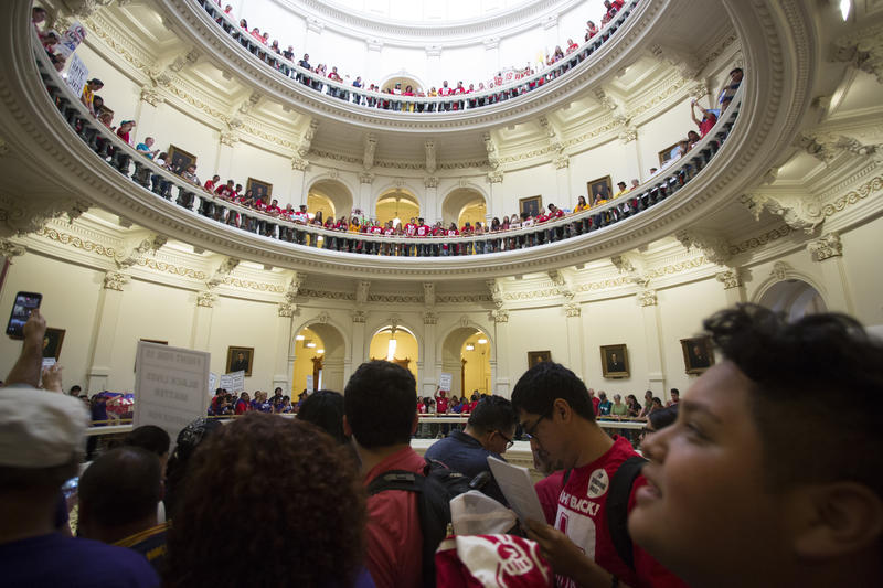 People gather at the state Capitol on May 29, 2017 to protest against the state's new immigration law.