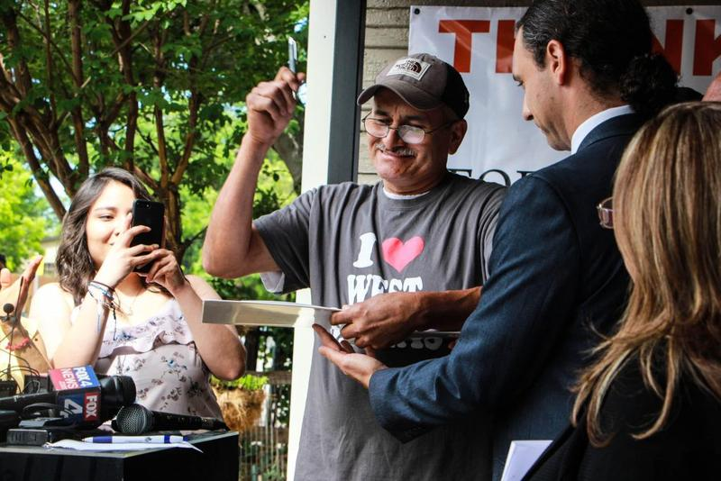 Merced Correa, a longtime renter in West Dallas, appeared at a news conference on Monday, May 22 to celebrate the rental house he bought from HMK Ltd.