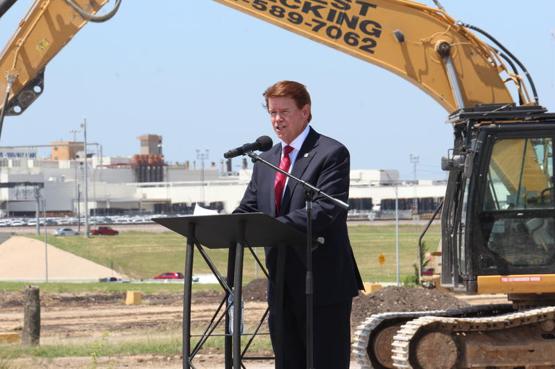 Arlington Mayor Jeff Williams spoke at a groundbreaking ceremony for a massive new development house suppliers who make parts for the General Motors Arlington Assembly Plant. The SUV factory can be seen behind Mayor Williams.