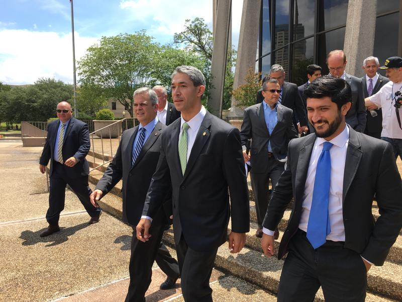 Left to right: Austin Mayor Steve Adler, San Antonio Mayor Ron Nirenberg and Austin City Councilman Greg Casar in front of the federal courthouse in downtown San Antonio.