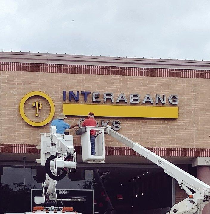 The finishing touches are made on the sign for Interabang Books, located at the corner of Preston Road and Royal Lane.