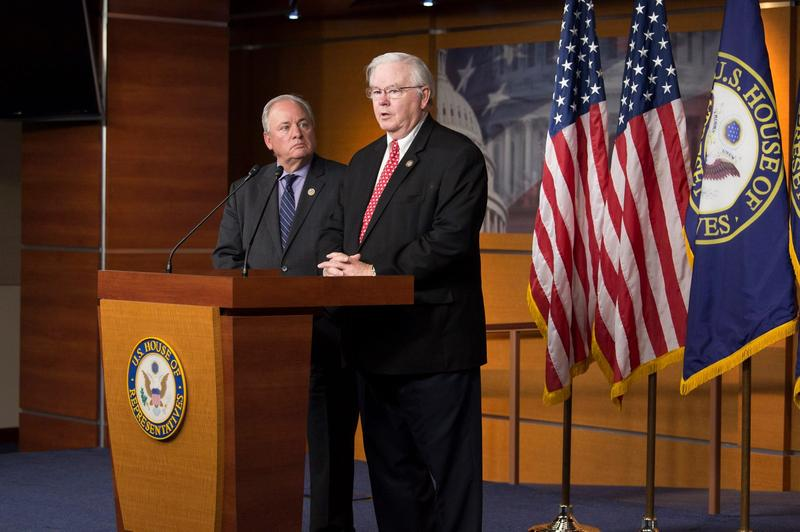 U.S. Representatives Joe Barton and Mike Doyle spoke to reporters after the shooting at a congressional baseball practice. Barton manages the Republican team and Doyle manages the Democrat players.