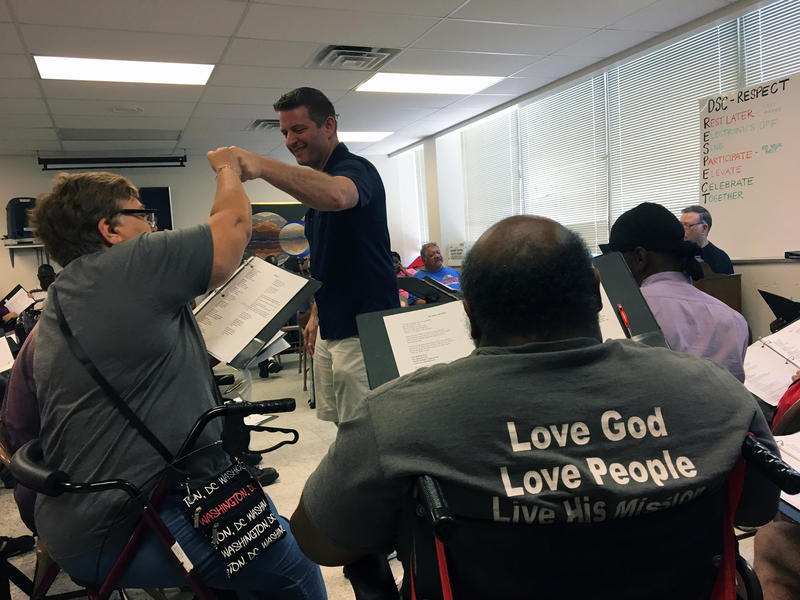 Jonathan Palant, founder and director of the Dallas Street Choir, leads a recent rehearsal with members.