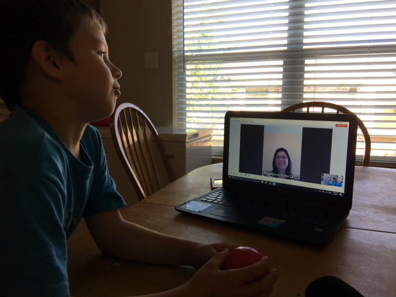 Josh Masters, 8, takes instructions on anxiety reduction from therapist Angeleena May during their virtual appointment. This fall, Children's Health will launch behavioral sessions with individual students in the Carrollton-Farmers Branch district.
