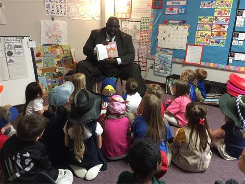 Roosevelt Nivens reading one of his favorite children's books to a class of students at McClendon Elementary.