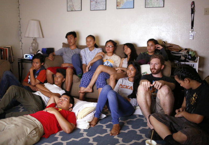 Alex Laywell joins a group of teenagers to watch the movie Little Giants. He and his wife, Laura, host movie nights at their Vickery Meadow apartment throughout the year.