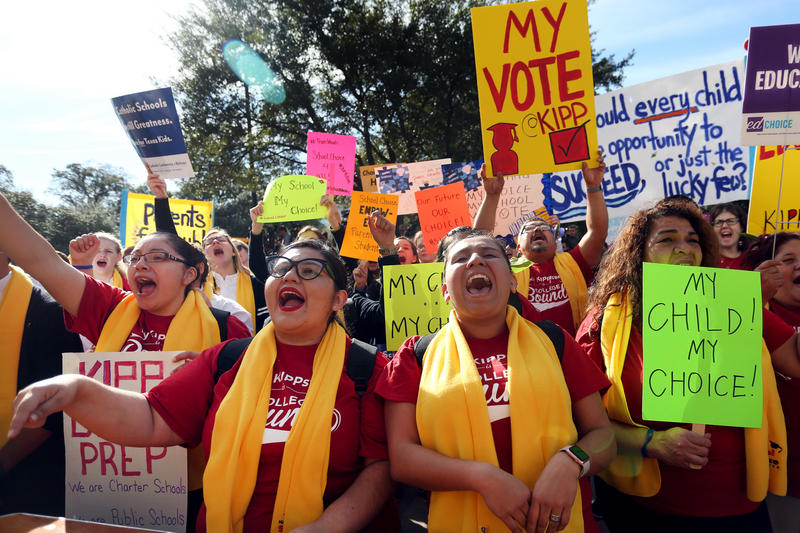 "Elizabeth Sandoval (L) Edith Gonzalez (C) and Gloria Aguilere (R) of KIPP Houston Public Schools cheer during a rally in support of ""National School Choice Week"" on Jan. 23, 2017."