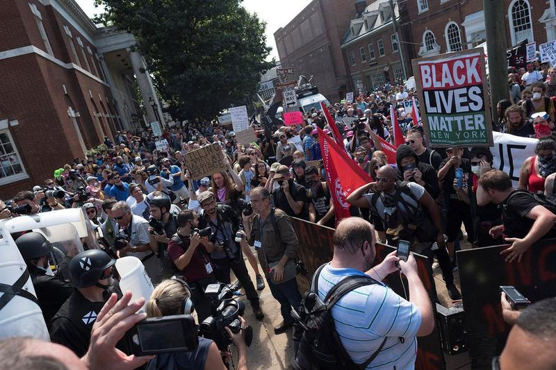 A crowd of white nationalists are met by a group of counter-protesters in Charlottesville, Virginia, U.S., August 12, 2017.