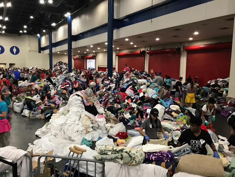 Donations sit in large piles in the George R. Brown Convention Center in Houston on Aug. 29, 2017.