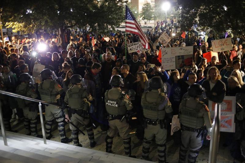 State police in riot gear face protesters at TAMU during white nationalist Richard Spencer's visit on December 6, 2016.