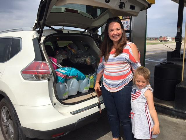Dejah Covick and her daughter Anastasia are heading back toward Houston, with a car full of supplies.