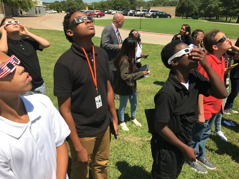 Students at Leonard Middle School in Fort Worth observe the eclipse on the first day of school.