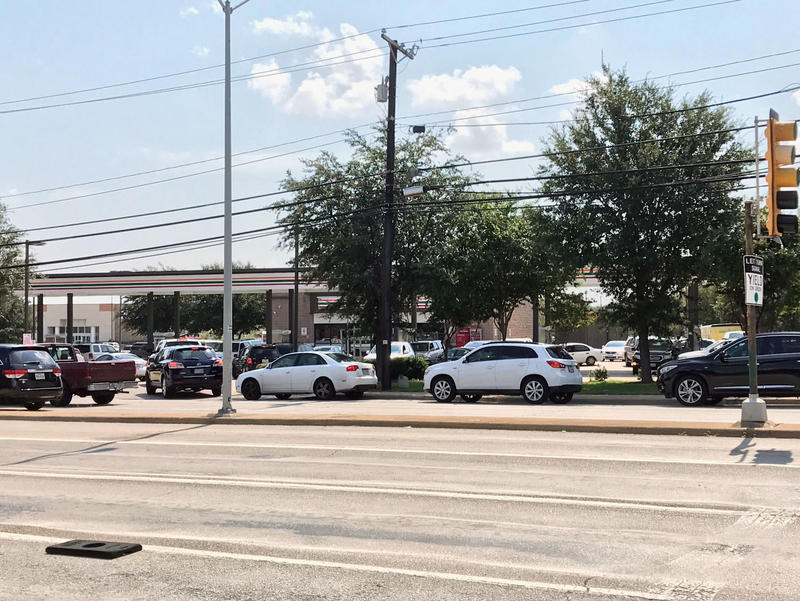 At the 7-Eleven at Skillman and Southwestern in northeast Dallas, regular gas was priced at $2.49 per gallon, but lines of cars at the entrance of the station overflowed into the road.