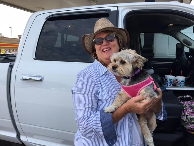 Marilyn Bird and her dog Molly are headed all the way to Oklahoma from a community near Baytown.