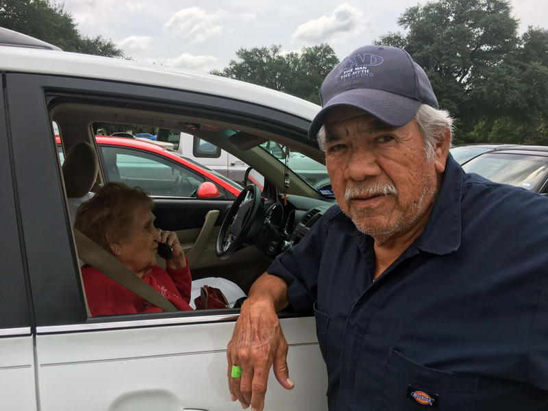 "Robert Lara, 74, and Amalia Salinas, 90, rode with family members from Freeport to Dallas. On Monday, they checked into a shelter after spending a few nights in a hotel. Salinas said, ""We have to get out. Not because we want to. Not party or vacations."""
