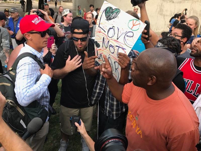 "Protesters and a man in a ""Make America Great Again"" hat had a tense exchange outside Dallas' Confederate War Memorial, which drew a crowd of onlookers and media before resolving peacefully, KERA's Chris Connelly reports."